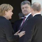File photo of Ukrainian President-elect Petro Poroshenko (C) German Chancellor Angela Merkel (L) and Russian President Vladimir Putin (R) talking during 70th anniversary of the D-Day landings at Benouville Castle, June 6, 2014. Reuters/Regis Duvignau/files