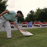 Drew Harris, part of U.S. Senator Lamar Alexander's (R-TN) advance team, places ''LAMAR'' signs prior to a campaign stop for Alexander as he campaigns in Dickson, Tennessee August 3, 2014. CREDIT: REUTERS/HARRISON MCCLARY