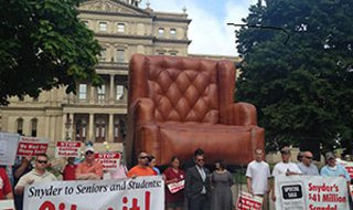 Democrats protest at the State Capitol. (Photo taken by Jacob Kanclerz, courtesy MIRS news)
