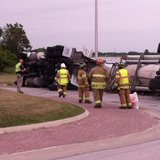 Fire and sheriff officials assess the situation after a tanker truck tipped at the Hwy 42/I-43 south roundabout.