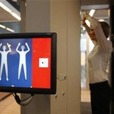 A security official demonstrates a full body scanner during a photocall at Departure Gate 2 at Hamburg Airport in Hamburg September 27, 2010. Credit: Reuters/Christian Charisius
