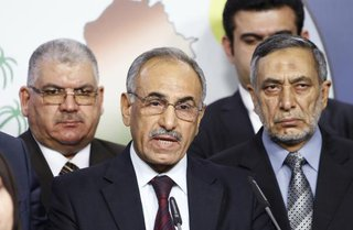Iraqi Sunni lawmaker Hamed al-Mutlaq (centre, L) speaks during a news conference about Friday's attack on a village mosque, in Baghdad August 23, 2014.Credit: REUTERS/Thaier al-Sudani