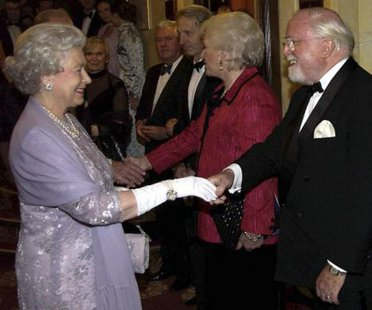 "Britain's Queen Elizabeth meets Sir Richard Attenborough and his wife at a gala performance of ""The Mousetrap"" in London, in this 2002 file picture. REUTERS/Stringer"