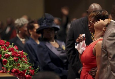 Lesley McSpadden reacts during the funeral services for her son Michael Brown at Friendly Temple Missionary Baptist Church in St. Louis, Missouri, August 25, 2014. Family, politicians and activists gathered for the funeral on Monday following weeks of unrest with at times violent protests spawning headlines around the world focusing attention on racial issues in the United States.  REUTERS/Robert Cohen/Pool