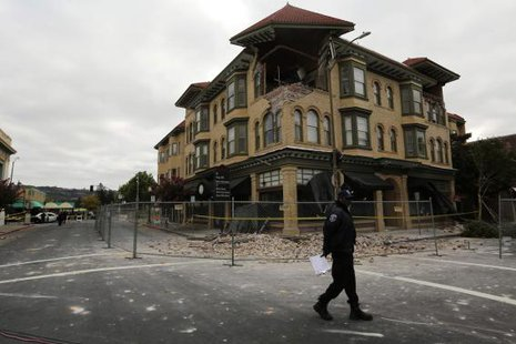 A security officer patrols an area in front of a building damaged by Sunday's magnitude 6.0 earthquake in Napa, California August 25, 2014. CREDIT: REUTERS/ROBERT GALBRAITH