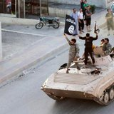 Militant Islamist fighters take part in a military parade along the streets of northern Raqqa province June 30, 2014. CREDIT: REUTERS/STRINGER