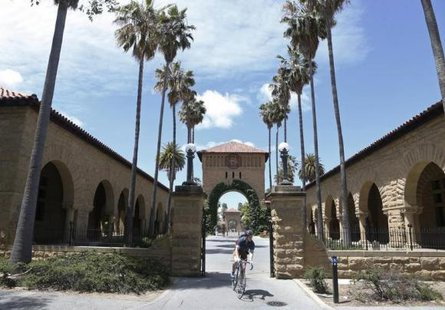 A cyclist exits the entryway to the Main Quad at Stanford University in Stanford, California, May 9, 2014. CREDIT: REUTERS/BECK DIEFENBACH
