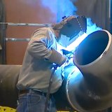 Welder working at Team Industries in Kaukauna. (Photo from: FOX 11/YouTube).