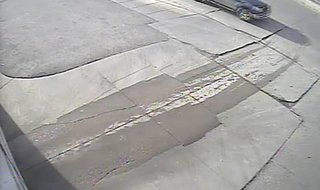 Surveillance image of truck sought by Minot police in hit & run.