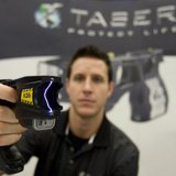 Brian Black of Taser International demonstrates the X26 model at a trade show for the Canadian. CHRISTINNE MUSCHI / REUTERS FILE PHOTO