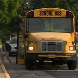 Kids get off the school bus for the first day of the 2014-15 school year at Baird Elementary School in Green Bay on Sept. 2, 2014. (Photo from: FOX 11/YouTube).
