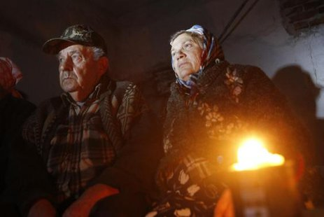 Local residents sit in a basement used as a shelter from artillery fire, in the village of Spartak, on the outskirts of Donetsk, September 1, 2014.  CREDIT: REUTERS/MAXIM SHEMETOV
