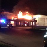 Fire crews respond to a fire at Ridgeway Trailer Co. in Ashwaubenon on Wednesday Sept. 3, 2014. (Photo from: FOX 11).`