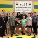 Social worker Andrea Pasqualucci of Valley View Elementary School in Ashwaubenon is honored as Wisconsin Special Services Teacher of the Year, Sept. 4, 2014. Pasqualucci, holding flowers, is surrounded by her family, school staff members and state Department of Public Instruction Superintendent Tony Evers. (Photo from: FOX 11).