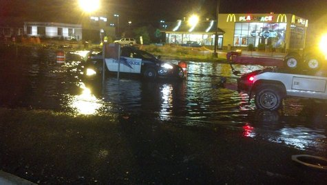 A Fargo Police car stalls in deep water in the 19th Ave. N. construction zone.