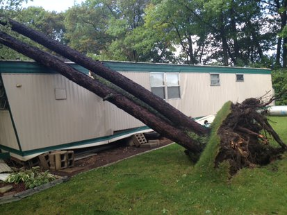 Uprooted tree falls on top of trailer home thanks to strong storms in north central and northeast Wisconsin. (Submitted photo from Wisconsin Public Service).