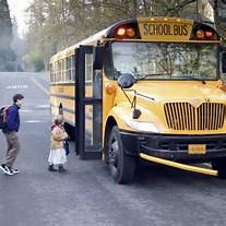school kids boarding bus