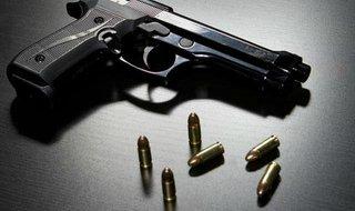 Handgun with bullets.