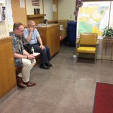 A same-sex couple is waiting to apply for a marriage license in Winnebago County on June 10, 2014. (Photo from: FOX 11).