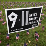 University of Wisconsin-Oshkosh College Republicans placed flags on the lawn of Oviatt House on campus. The group placed 2,977 flags - one for each 9/11 victim. (Photo from: FOX 11).
