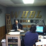 Dane Checolinski with Sheboygan County Economic Development Corporation speaking in the WHBL studio with Kelly Meyer.