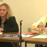 Lisa Kotter, left, and Clintonville Mayor Judith Magee attend a city council meeting. (Photo from: FOX 11/YouTube).