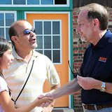 Hope College President John Knapp (R) greets unnamed local residents during the 2013 Hope College/City of Holland Community Day activities on Windmill Island Gardens. (photo courtesy Hope College)