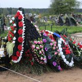 A freshly dug grave, believed by some locals to hold the body of a Russian paratrooper killed fighting alongside rebels in Ukraine, is seen at the Vybuty public cemetery in the Pskov region of northwest Russia in this August 27, 2014 file photo. REUTERS/Dmitry Markov/Files