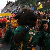 Fans cheer as Thundar arrives for the ESPN College Gameday broadcast in downtown Fargo on Saturday September 13th, 2014.