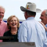 Former U.S. Secretary of State Hillary Clinton (2nd L) is joined by her husband former U.S. President Bill Clinton (L) and Senator Tom Harkin (R) at the 37th Harkin Steak Fry in Indianola, Iowa, More... CREDIT: REUTERS/JIM YOUNG