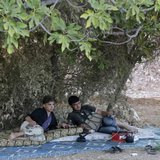Free Syrian Army fighters rest on one of the frontlines of Wadi Al-Dayf camp in the southern Idlib countryside September 14, 2014.  CREDIT: REUTERS/KHALIL ASHAWI
