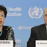 World Health Organization (WHO) Director-General Margaret Chan (L) pauses next to Cuba's Minister of Public Health Roberto Morales Ojeda during a news conference on support to Ebola affected countries, at the WHO headquarters in Geneva September 12, 2014. REUTERS/PIERRE ALBOUY