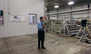 Governor Scott Walker talks to employees at Meca & Technology Machine in Ashwaubenon on September 15, 2014. (Photo Copyright Midwest Communications, Inc.)