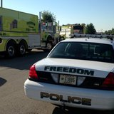 Emergency crews respond to a fatal accident involving a recycling truck, Sept. 17, 2014, in Freedom. (Photo from: FOX 11).