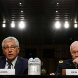 U.S. Secretary of Defense Chuck Hagel (L) and Chairman of the Joint Chiefs of Staff Gen. Martin Dempsey testify during the Senate Armed Services Committee hearing on U.S. policy toward Iraq and Syria and the threat posed by the Islamic State on Capitol Hill in Washington September 16, 2014. CREDIT: REUTERS/KEVIN LAMARQUE