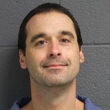Lifer Michael Elliot enters a guilty plea to  escape, but why is he smiling? (Photo courtesy of the Michigan Department of Corrections)