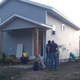 Front of the home on Wisteria. Freshly sided with a new roof. (photo by John McNeill)