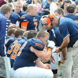 Hope College coaches talk with their players in 2013 game action (photo courtesy Hope College)
