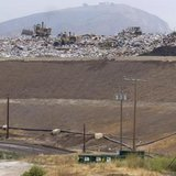 Bulldozers move trash atop of a 300-feet tall hill at the Simi Valley Landfill and Recycling Center in Simi Valley, California May 8, 2008. CREDIT: REUTERS / HECTOR MATA