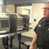 Kalamazoo County Sheriff Richard fuller shows off the new visitation center with over a dozen screen positions. (photo by John McNeill)