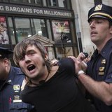 New York City police officers arrest a man taking part in the Flood Wall Street demonstration in Lower Manhattan, New York September 22, 2014.  CREDIT: REUTERS/ADREES LATIF