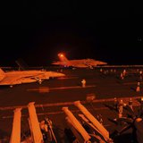 An F/A-18E Super Hornet, attached to Strike Fighter Squadron (VFA) 31, and an F/A-18F Super Hornet, attached to Strike Fighter Squadron (VFA) 213, prepare to launch from the flight deck of the aircraft carrier USS George H.W. Bush (CVN 77) to conduct strike missions against ISIL targets, in the Arabian Gulf in this U.S. Navy handout photograph provided September 23, 2014. CREDIT: REUTERS/U.S. NAVY/MASS COMMUNICATION SPECIALIST 3RD CLASS ROBERT BURCK/HANDOUT VIA REUTERS