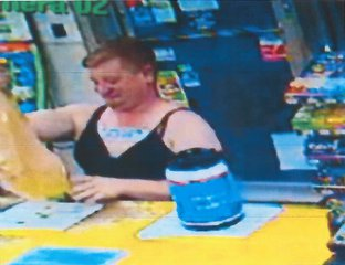 The suspect is seen here in a video still from surveillance video (courtesy of the Calhoun County Sheriff's Department).