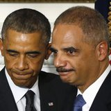 U.S. Attorney General Eric Holder (R) stands with President Barack Obama after the president announced Holder's resignation in the White House State Dining Room in Washington, September 25, 2014. CREDIT: REUTERS/LARRY DOWNING