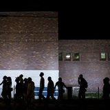 Protesters march in front of the police department during a rally in Ferguson, Missouri, September 26, 2014. Credit: Reuters/Whitney Curtis