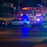 Authorities investigate what they describe as a double homicide in the 200 block of Broadway St. in Berlin, September 28, 2014. (Photo from: FOX 11).