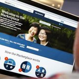 A man looks over the Affordable Care Act (commonly known as Obamacare) signup page on the HealthCare.gov website in New York in this October 2, 2013 photo illustration. CREDIT: REUTERS/MIKE SEGAR