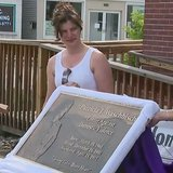 The dedication of the Patricia Waschbisch Center for Domestic Violence, formerly Rainbow House, in Marinette. (Photo from: FOX 11/YouTube).