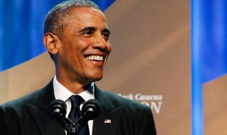 U.S. President Barack Obama smiles before his remarks at the Congressional Black Caucus Foundation dinner in Washington September 27, 2014. CREDIT: REUTERS/JONATHAN ERNST