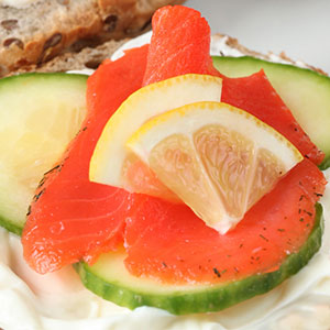 Smoked salmon on cucumber slices.